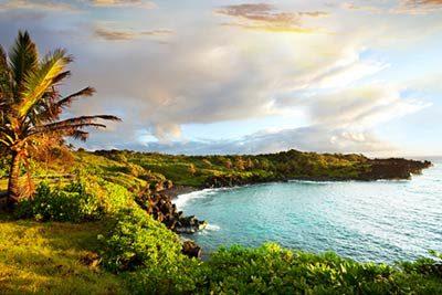 Sonnenuntergang auf Hawaii am Strand